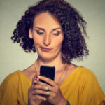 upset skeptical unhappy serious woman talking texting on phone