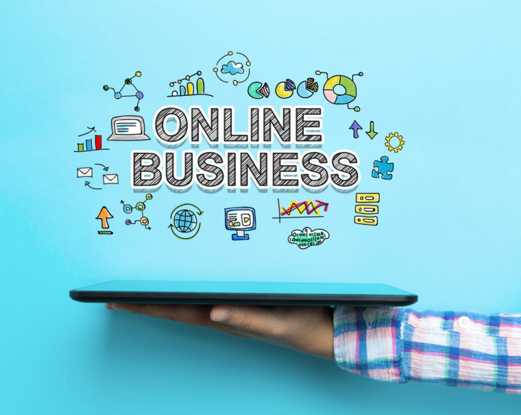 Online Business concept with a tablet on blue background