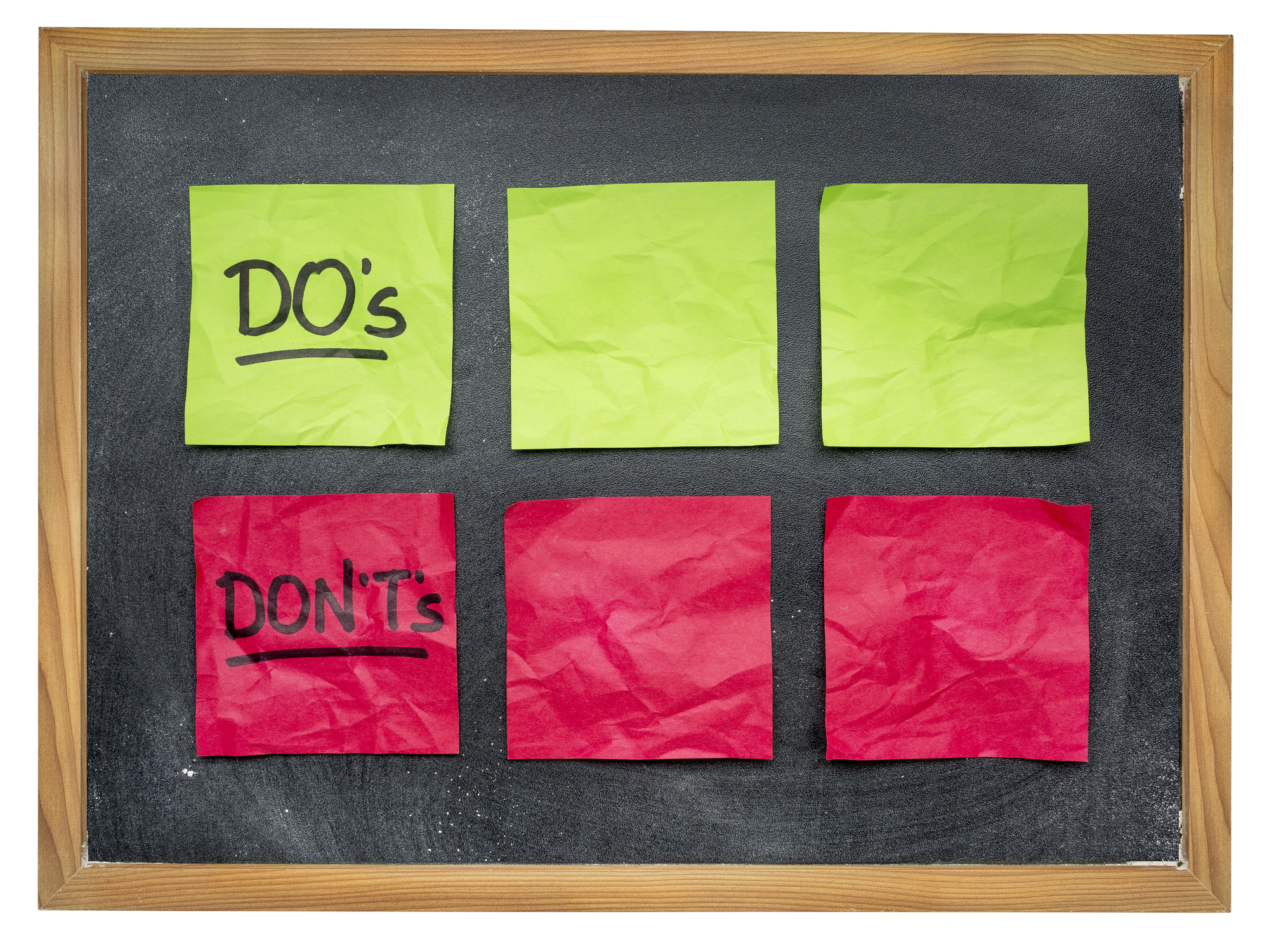 do's and don't's - things to do and not - blank sticky notes on on blackboard
