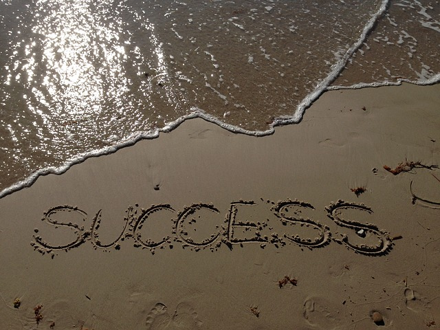 The word SUCCESS written on the sands of a beach