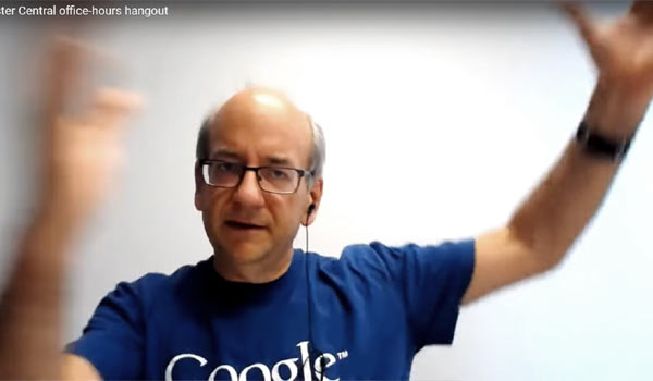 Google's John Mueller gesticulating as he answers question about Google's SERP feedback form.