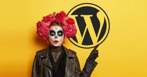 Image of a scary face painted woman pointing to a WordPress logo