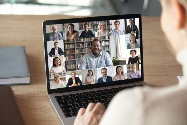 Colleagues gather in a remote video conferencing meeting.